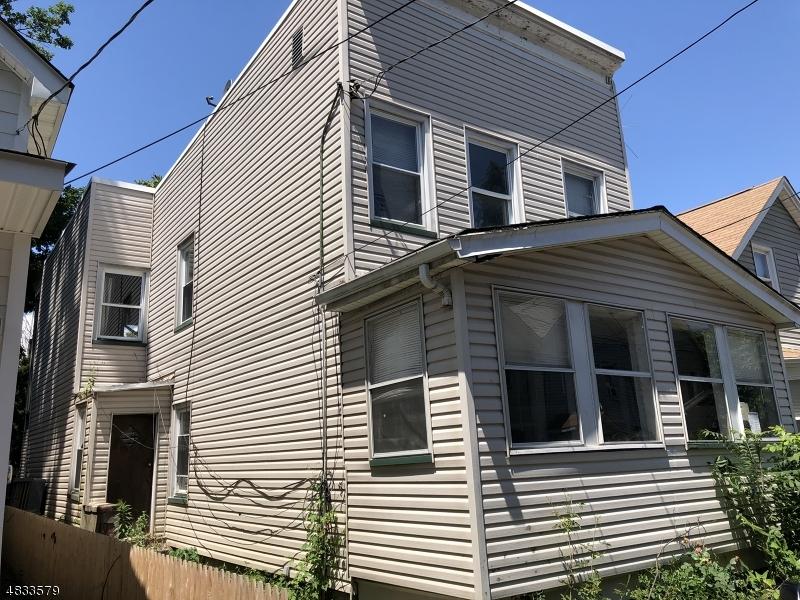 Maison avec plusieurs logements pour l Vente à 473 FLAGG Street Orange, New Jersey 07050 États-Unis