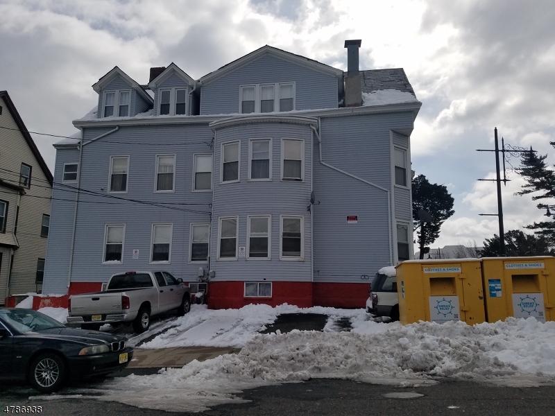 Maison avec plusieurs logements pour l Vente à 1049-1051 MAIN Street Paterson, New Jersey 07503 États-Unis