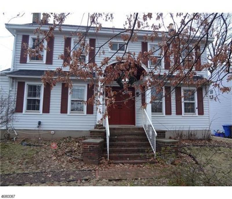 Maison unifamiliale pour l Vente à 657 E Woodbridge Avenue Avenel, New Jersey 07001 États-Unis