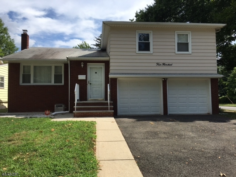 Частный односемейный дом для того Продажа на 400 E 6th Avenue Roselle, Нью-Джерси 07203 Соединенные Штаты