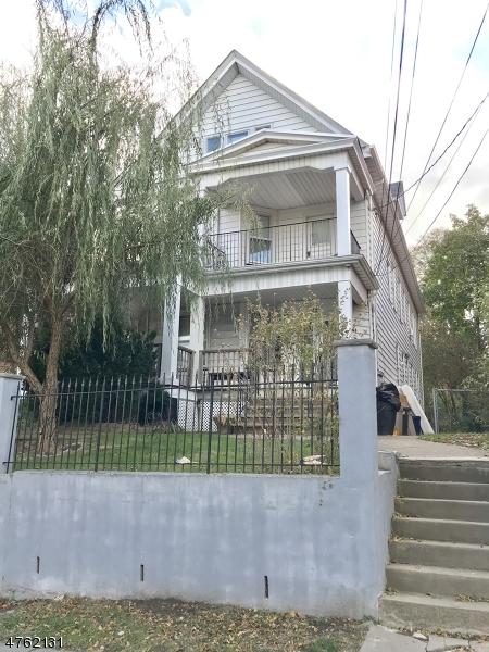Многосемейный дом для того Продажа на 15-17 WESTERVELT Place Passaic, Нью-Джерси 07055 Соединенные Штаты