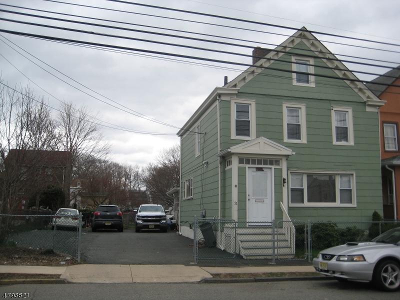 Maison avec plusieurs logements pour l Vente à 52 S JEFFERSON Street Orange, New Jersey 07050 États-Unis