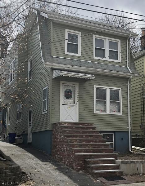 Maison avec plusieurs logements pour l Vente à 320 Elizabeth Street Orange, New Jersey 07050 États-Unis