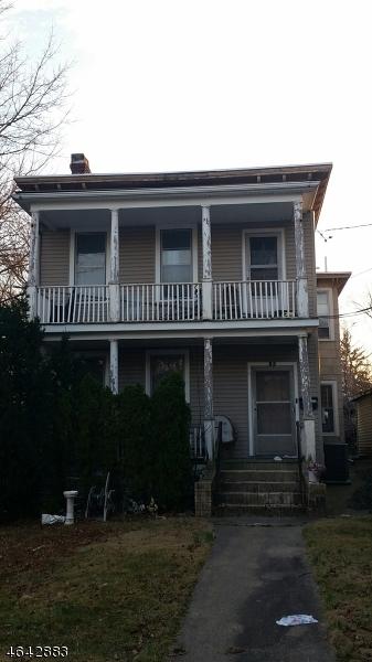 Многосемейный дом для того Продажа на 77 Westervelt Place Passaic, Нью-Джерси 07055 Соединенные Штаты