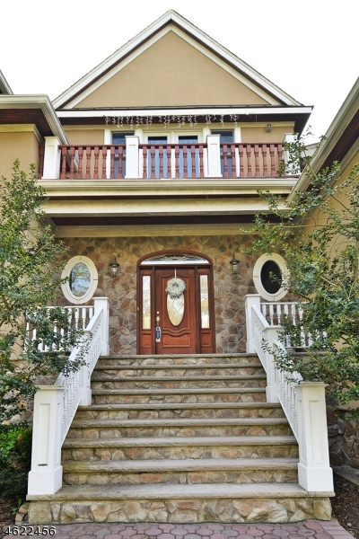 Builders own home.  Luxurious - custom moldings, built-ins, flooring, beautiful ceilings & finish work!  Fenced property w/ gate.  Optional 1st or 2nd floor MBR.  Outdoor fireplace & gorgeous  in ground pool.  A must see!  Pert NJ ACTB 4403 sqft!  1 Year Basic Home Warranty Provided to Buyer at Closing!