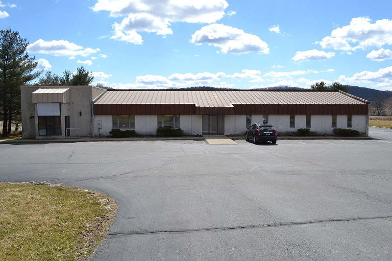 Available 2,500 SF Warehouse space at rear of the building ideal for contractor or car storage.   Owner will install a 12' OH drive in door. Plenty of outside parking.