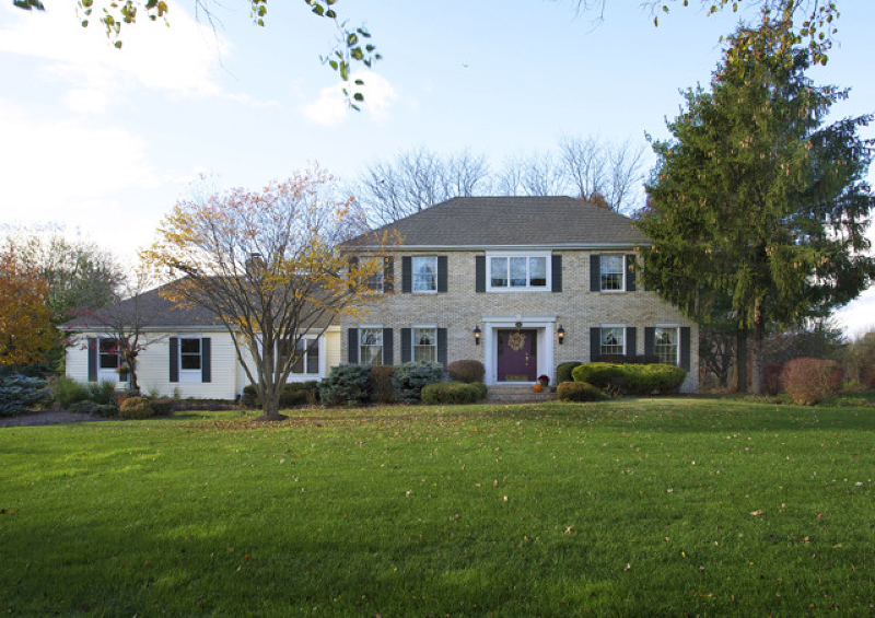 Stately Brick Front Colonial featuring four bedrooms & two and one half baths is nestled on three + landscaped, park-like acres where manicured lawns, mature trees captivate and an entertainment-sized