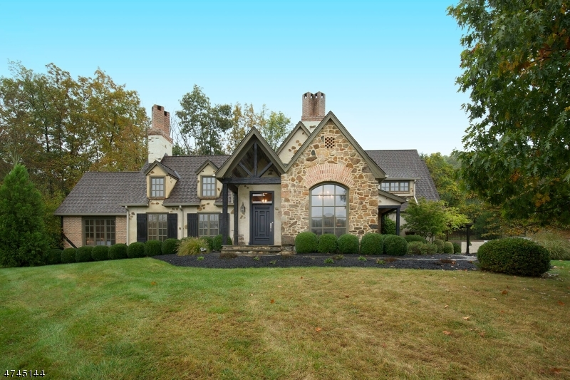 Stone and stucco Manor regally set  10+ acres of privacy and natural beauty. Enjoy views of rolling meadows and colorful gardens from this exquisitely-crafted European-style home just minutes from I-78 and charming Oldwick. 1998 custom built and thoughtfully updated in 2012  presents upgraded chef's kitchen with upper-end stainless steel appliances, center island, granite counters and Signature cherry cabinets adjoining fireside breakfast room. View-filled dining room and living room anchored by fireplace, both with vaulted beamed ceilings, are stunning special occasion spaces. Family room overlooks professionally-designed perennial gardens. Master suite offers sitting area, spa bath, patio access. Detailed floor plan and serene setting. Two car attached garage.
