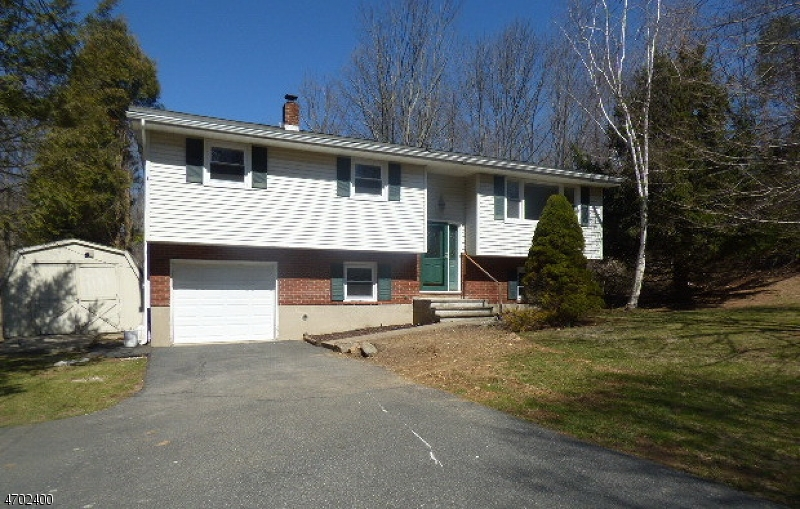 Lovely Bilevel home with 4 bedrooms and 1.5 bath, nice landscaped level lot. Deck overlooks large backyard with a stream. Nice wood floors throughout upper flr. Finished lower level walkout to patio . Property has public water and sewer.   New above ground oil tank outside.