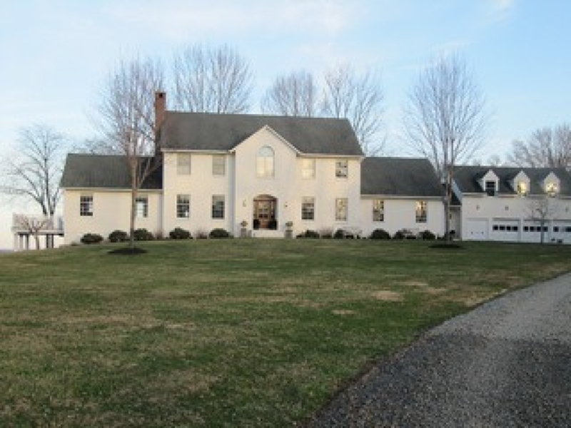 Estate-Caliber, Custom-Built Country Colonial with tennis court on 7.80 landscaped, farm assessed, cul-de-sac acres bordering 200 acres of preserved land. One-of-a-kind offering in Tewksbury Township!