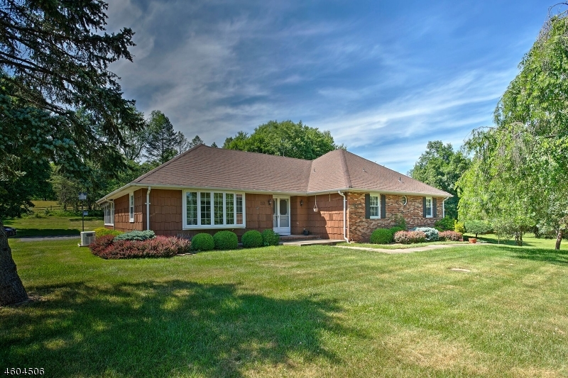 Gracious Brick and wood shingle, 3bedroom, 2 bath Ranch, built-in 1976, is set on 1.9+ open/level acres in a neighborhood of homes in Whitehouse Station, minutes from train service, shops and restaurants. Features include: hardwood floors, family room with wood burning fireplace, enclosed porch, recent ss wall oven, forced air heat and air conditioning, central vacuum, patios, built in generator, 2 storage sheds, 2 ample parking areas, and 2 car attached garage.