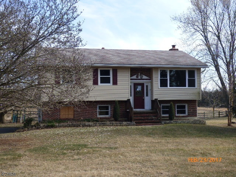 Large three bedroom bilevel with large rooms, hardwood floors in living room, dining room and all bedrooms. Large family room in lower level with wood burning fireplace.Lower level also has powder room and sliders onto paver patio.  Also has large deck off kitchen on upper level.