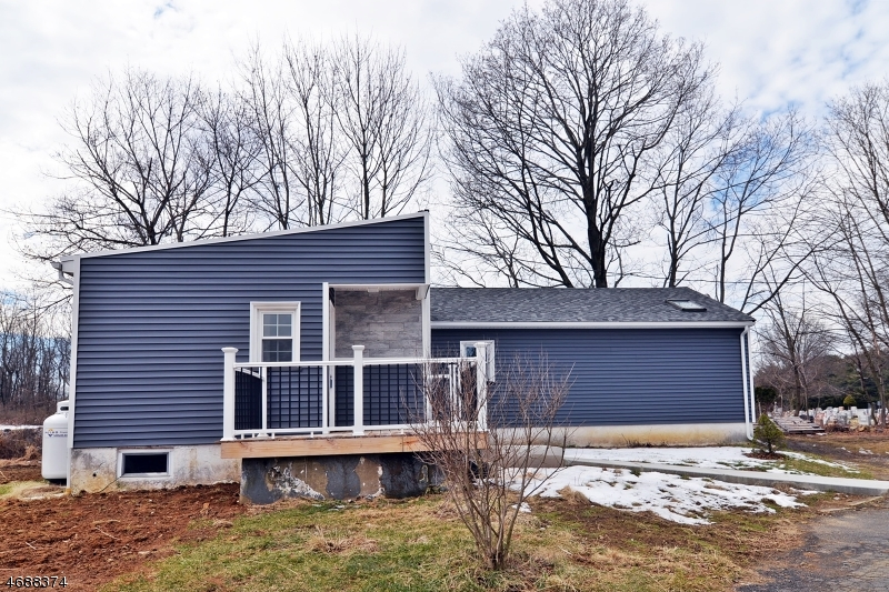 2 Homes on 5+ acres with 40 + Apple trees & Large Garage / outbuilding. House A: Recently renovated RANCH w/ new Laminate flooring, Baths, EIK, Roof, Siding & Windows. 2BR & 2 Bath.  House B: 2 Story  - currently a Rental with 5 Rooms.  2 BR one upstairs and one down, 1 FULL Bath first floor, EIK, Family Room, & Living room. Beautiful Level & Open Farm type land. TAXES reflect A total for both houses on property.