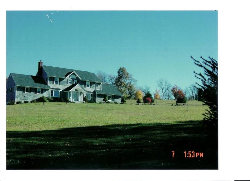 Charming Cedar Shingle Colonial brimming with character with partially finished walk-out lower level and crowning rolling views sits majestically on three open, sweeping pastoral acres. Outstanding features include 2002 addition cathedral ceiling entry foyer vestibule, 1995 living room/great room addition with Palladian window and brick wall, wood burning dual see-through fireplace to gourmet kitchen presenting oak whitewashed cabinetry topped by gleaming granite counters and bay window breakfast area, office/den, master suite with built-ins, walk-in closet and luxurious dual sink vanity master bath with jetted tub. Below ground oil tank to be removed.