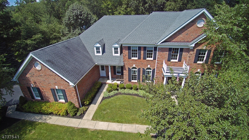 GREAT OPPORTUNITY! Beautiful Luxury ENERGY STAR HOME located one mile from the center of Sparta. Brick colonial home w/plenty of upgrades. Natural GAS, Public Water in a finished Toll Bros.community. This gorgeous home has architectural features & attention to detail throughout : Upgraded lighting, custom molding & well thought out floor plan. Formal LR & DR w/butler's Pantry. Step down FR w/Columns & Brick Fpl, 1st flr Office has Fr Drs & space for a bar. Upgraded Cherry Kitchen w/charming Bkfst area to screened porch & Trex deck. Convenient Laundry Rm. Front & back staircase to 2nd floor. Fr Drs to elegant MBR Ste w/Sitting Rm, HUGE walkin Closet & luxurious Bath. Each Bedrm has  own /Priv Bth with  closets w/organizers.Underground Electric Dog Fence around yard.