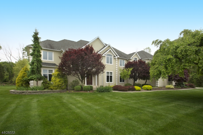 Nestled on just over 2 gorgeously landscaped acres, a stately 2000-built Colonial enjoys a country club lifestyle in the Stanton Ridge golf community. A detailed 5,200 square-foot layout is enhanced by an additional 2,464 square feet of space in the finished walkout lower level. Sun-filled floor plan offers 5 bedrooms, 5 full baths. Entertainment-friendly paver patio overlooks park-like scenery. Interior highlights include 2015 chef?s kitchen, fireside master suite and luxury master bath, great room tucked under vaulted ceilings with fireplace and wet bar, formal living and dining rooms and 1st floor guest room. Close to I-78/22, 202, Round Valley