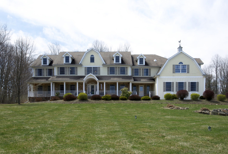 Estate-Caliber, 2003 Custom-Built Stone Front Colonial at Stone Row nestled on five plus landscaped, cul-de-sac acres presenting resort-style pool and four car attached garage.