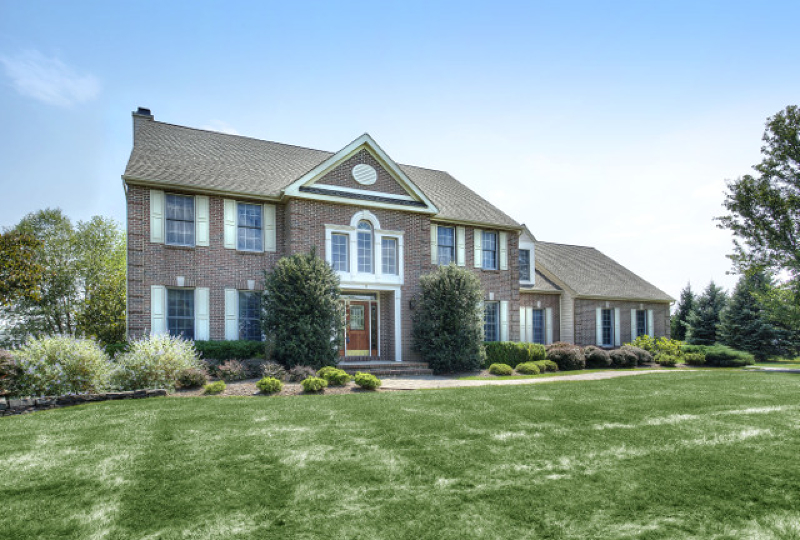 High levels of elegance and sophistication define a brick front Colonial in Readington's prestigious Stanton Ridge neighborhood. The spacious five bedroom, three-and-one-half bath floor plan features a private first floor in-law suite. Over 2 landscaped acres bordering the golf course surround this cul de sac luxury home. Highlights of the open floor plan include an excellent balance of formal and informal spaces featuring hardwood floors, classic moldings, high ceilings and recessed lights. Living and dining rms flank the dramatic two-story foyer. A gourmet center island kitchen opens to a window-walled family room anchored by a gas fireplace. Upstairs, a tray ceiling master bedroom adjoins a separate sitting room and luxurious master bath. The finished lower level offers media, exercise and recreation rooms