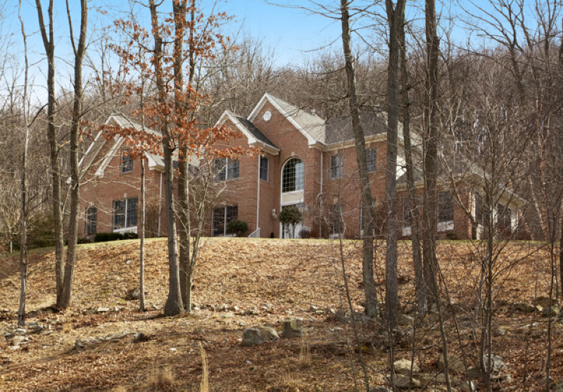 Elegant brick front Colonial on private cul de sac of custom homes w/distant views. Minutes from I-78 and Califon village's shops, eateries and schools.Open floor plan w/hardwood floors, high ceilings , gas fireplace, extensive moldings, recessed lights, large windows. 2-story foyer, formal LR/DR, sunny conservatory, den, chef's center island granite and stainless kitchen opens to fireside 2-story great room. Entertainment-friendly paver patio overlooks professionally landscaped views. Grand master suite w/sitting room, bonus room and marble-accented spa bath. Additional features include unfin. basement, built-in generator, 3-car gar. Truly refined country living.