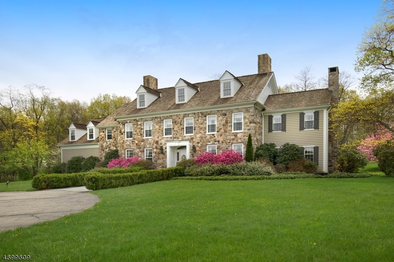 2017 Tax Assessment Reduction to $1,050,000   Classic Colonial Revival Stone & Clapboard w/wood shake roof deep set on premier 8+level acres with 6700 sq ft of stately grace & charm w/raised panel walls, art niches, custom molding treatments, 3 stone/marble façade fireplaces, soaring cathedral ceiling great rm w/stone wall fireplace, gourmet kitchen with breakfast area, exceptional replica library with fireplace, master bedroom suite w/fireplace, sitting room and lux master bath, spacious bedrooms and 6.5 baths. Outdoor oasis presenting bluestone patios and extensive landscaping and four car attached garage.This gracious rural haven stands as an embodiment of our colonial roots, providing within its picturesque perimeters a way of life to be especially treasured today.