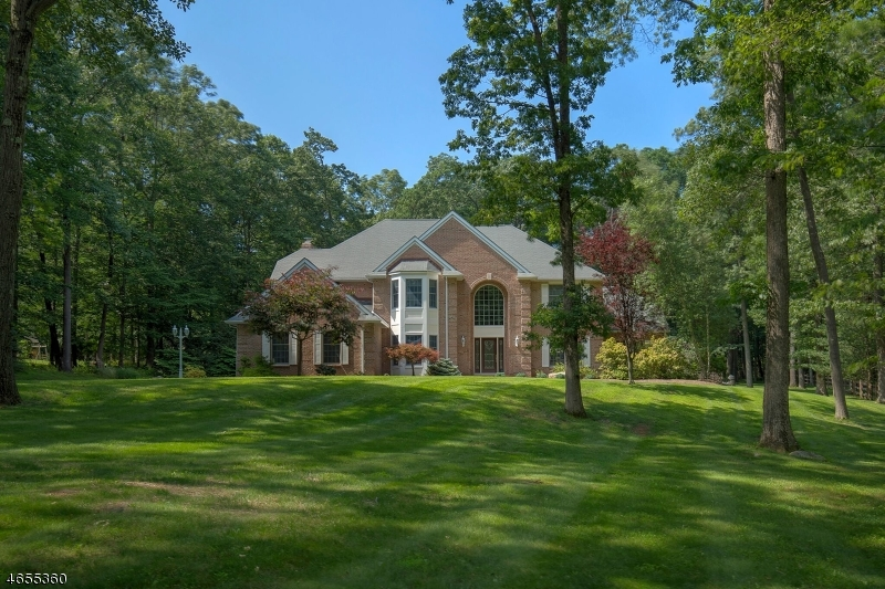 A spectacular variety of design upgrades  and pride of ownership characterize this impressive custom brick-front Colonial built in 1998 and situated on 2.98 acres at the end of a quiet cul-de-sac. Privately fenced backyard includes pool outdoor Viking grill; all surrounded by beautiful landscaping. Inside, the owners have invested over $250K in renovations to enhance this move-in ready home. Upgrades are seen throughout the new chef's kitchen, master bath, guest bath and finished basement. Gourmet kitchen presents custom cherry cabinetry, granite countertops and Viking/Bosch SS appliances; it opens to a bar/great room with wood-burning stove. The first floor also has a library with custom cherry cabinets, sun-filled conservatory and gracious family room. Second floor master bedroom offers two walk-in closets, and private master bath features subway tile, marble countertops with two sinks, custom cherry cabinets, heated floor and heated towel bar.  Guest bath fitted with a marble mosaic floor and glass wall tile. Additional living space in the 1,600 square-foot finished basement includes a fitness room, large recreation room, half-bath, Andersen acoustic ceiling tiles and commercial carpeting. Two-zones of hot air heating/AC and radiant hot water heating.