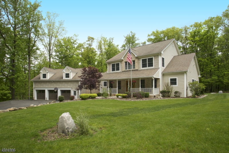 Custom Crafted Colonial, 2005 built, 4300+ sq ft, four bedroom 3.5 baths with walk-out lower level nestled on 5.99 landscaped acres.