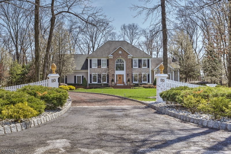 Beautifully updated custom Colonial on 4.08± landscaped acres. Built in 1994, the 3.975+ square foot open floor plan offers 4 bedrooms and 3.5 baths.  Under 10 miles to I-78 for commuters, central location is near Round Valley Recreation Area, shops, dining, schools and golf courses. Park-like setting offers pastoral countryside views. Interior features include oak floors, soaring ceilings, rich millwork, French doors,  brick fireplace in family room, center island gourmet granite kitchen, elegant master suite, finished lower level w/entertainment kitchen, gathering spaces and full bath.
