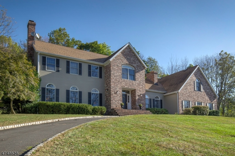 Pride of ownership seen in impeccable, (1987 built-updated 2017) Brick Front Colonial presenting 2.35 private prof. landscaped grounds, patio & panoramic views. Open floor plan features three bedrooms 2.5 baths, crown molding treatments, neutral paint colors, welcoming two-story foyer, impressive fireside living room opens to dining room edged in wainscoting, gourmet granite kitchen with newer stainless steel appliances, spacious breakfast room, vaulted ceiling family room with towering brick fireplace connects to view-filled sunroom. Spacious bedrooms upstairs include expansive master bedroom, huge spa master bath and potential in-law suite in oversized bonus room with separate entrance. Two car garage. Prime Oldwick location near I-78. 2011 installed septic system.