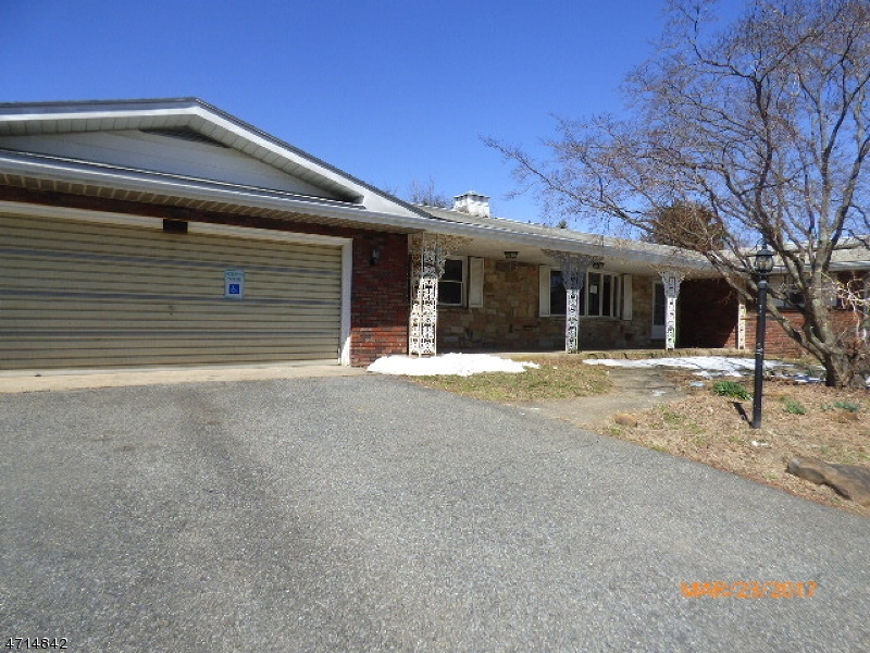 Large brick Ranch style home with 3 BR 2 bath, LR, DR, FR, kitchen, laundry room on 1st level, basement has 2 bedrooms, rec room. Nice level yard with oversized 2 car garage. First look expires June 5, 2017 only owner occupant offers will be considered during this time.  Sold AS IS all inspections and C of O are the responsibility of the buyer. Fireplace wood burning  in family room.