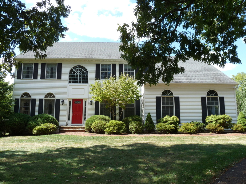 Pride of Ownership Though-Out !  Colonial featuring four bedrooms, 2.5 baths, gourmet kitchen with 2015 s/s appliances, vaulted ceiling family room with brick wall, wood burning fireplace,  den, master bedroom suite presenting sitting area and lux bath, 2000 screened-in-porch with tongue-n-groove cathedral ceiling, raised rear paver patio nestled on one plus cul-de-sac, landscaped garden acres backing to open space parkland