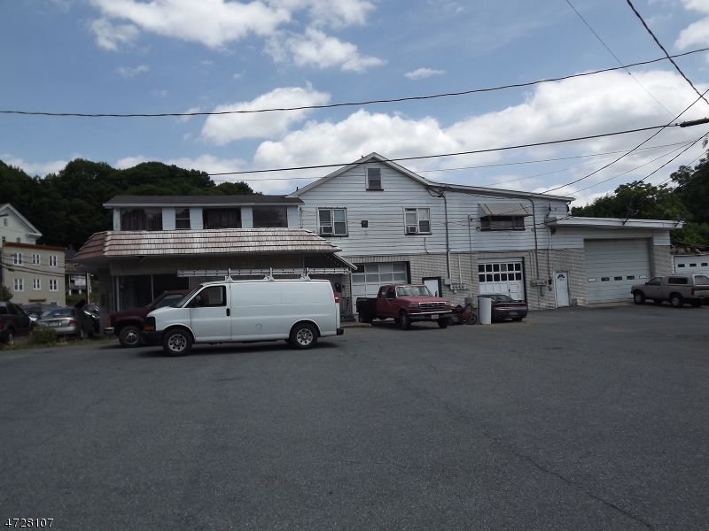 Great opportunity - Sale includes (5) lots (34,35,36,37,38) and a total of 1.48 acres.  Large commercial building with 3 bay garage facing S Main St. and 3 other bays on side of building. 3 apartments located on 2nd floor.  2 small out buildings that were used car sales offices. PLUS 2 single family homes AND 2 vacant lots.  Property is being sold AS - IS.  Current rentlal income is $6,875/month.