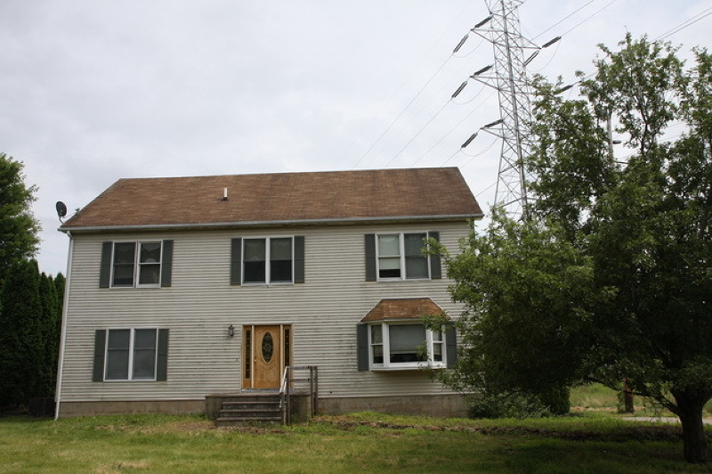 Large 4 bedroom colonial with open floor plan on beautiful lot.  LENDER APPROVAL IS REQUIRED.  Property is being sold in AS IS condition.