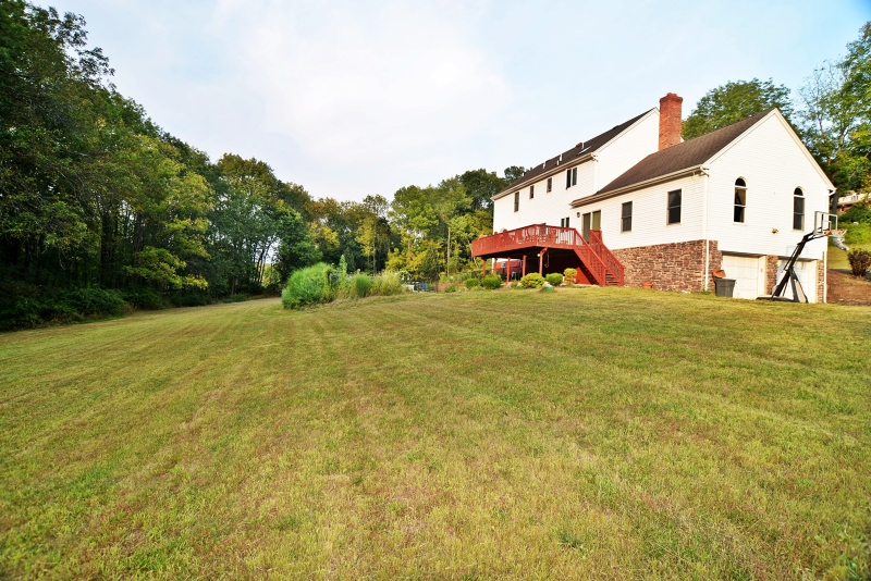 Large colonial sits on 6+ acres of land.  This house features large rooms, a Great Room with a stone fireplace, eat-in kitchen, formal dining room and four large bedrooms.  The master bedroom has a private bathroom with a whirlpool tub and walk-in closet.  Step outside and enjoy the large open yard leading into the woods with a river flowing through.