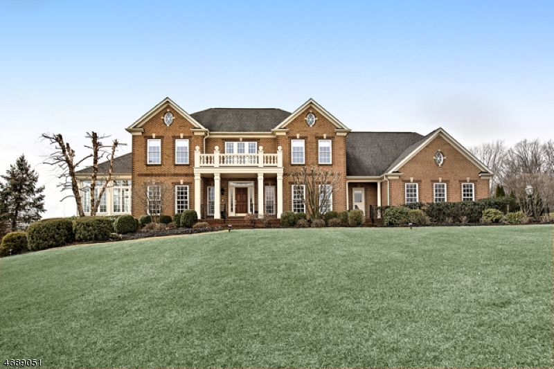 Estate-Caliber, 2003 Built Brick-Front Colonial presents four bedrooms, 4.5 baths, finished day-light walk-out lower level, resort-style pool and two-tiered patio nestled on two plus, professionally  landscaped premium acres at the