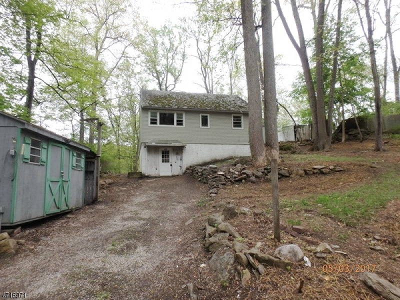 Lake style home in the Paulinskill Lake Community.  Great summer home or a start up home with 1 bedroom and 1 bath.  Large trees on the property. Nice views of the lake from the rear yard.