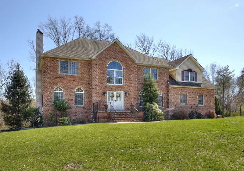Brick-Front, 3900 square-foot, 4 bedroom, Colonial built in 1997 with in-ground pool and walk out basement is set on 4.69 acres, minutes from I 78, near the Oldwick area.  Introduced by a two-story for year, this gracious residence features hardwood floors, French doorways,  custom millwork,  spacious rooms including kitchen with granite counters, Family room warned by wood burning fireplace and 1st level den. The 2nd level boasts a large master bedroom with walk-in closet and jetted tub bath. There are three remaining bedrooms and hall bath. natural gas heated and air-conditioned.