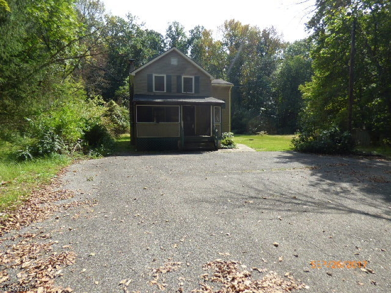 Colonial with 3 bedrooms and 1 bath, country setting, with a brook, woods at rear, private. Sold As IS all inspections and C of O are the responsibility of the buyer. First look expires Oct 19, 2017  only owner occupant offers will be considered during this time.  Property consists of Block 91 Lot  4 & 5 (1.52 acres) in Lopatcong Twp. and Block 1 Lot 4 (13.06 acres) in Greenwich Twp.