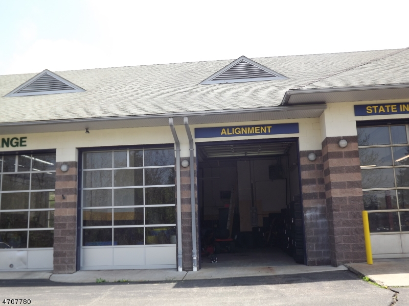 Highway location. 2 overhead door shop space available towards the rear of Goodyear Plaza. Plenty of on-site parking. Zoning allows for a variety of uses.  1,000SF office/retail space also available if needed - MLS#3381993