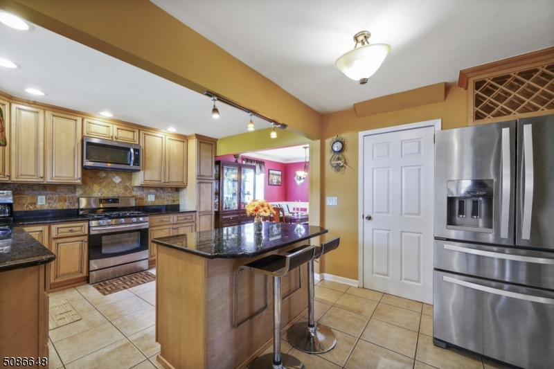 Beautiful Updated Kitchen with Island and granite and stainless steel appliances!