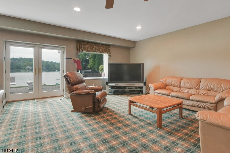 Game Room with door to patio, hot tub and lake