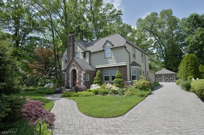 A 1923 American Center Hall Colonial Tudor Revival Full Restored to its original grandeur but with 21st Century Conveniences.