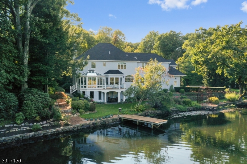 Enjoy this exquisite custom home set on a meticulously landscaped lot with breathtaking lake views!