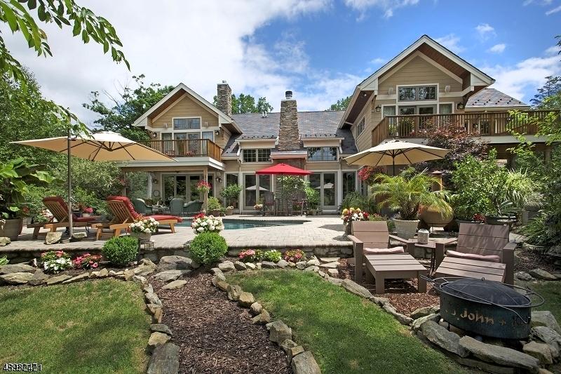 Award winning Acorn Custom Builder home offers original interior & exterior details. Designed to bring the outdoor nature in!