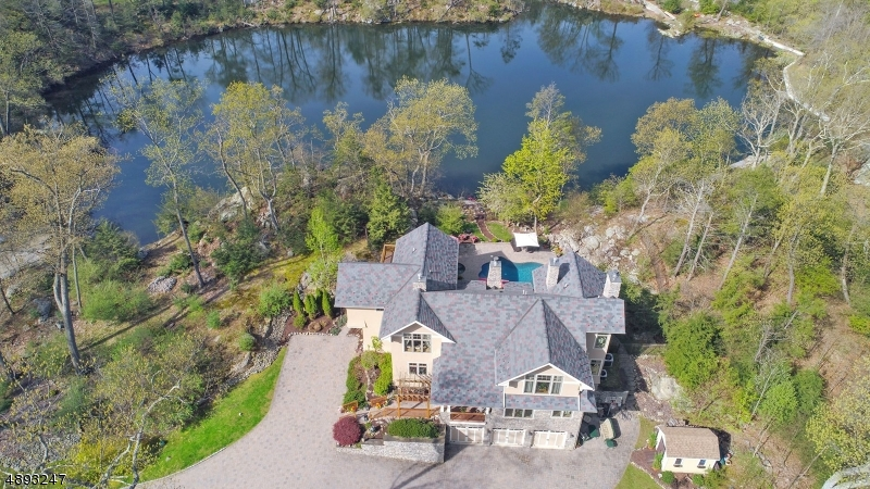 1 of 4 Custom designed homes in this exclusive enclave location. 7.16 acres water front living. Shared sandy beach with kayak entry.