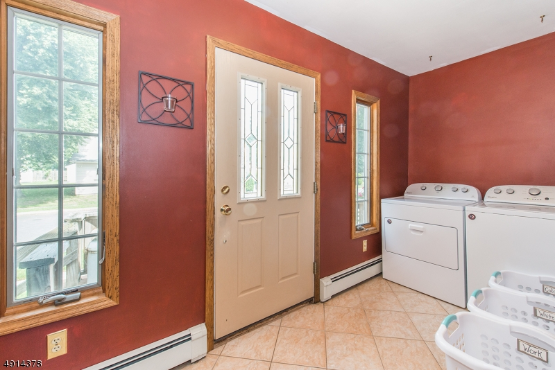 Laundry room here is more convenient than lugging all the way to the basement.