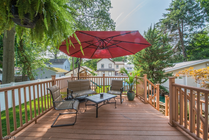 Trex Decking , Great view of lush yard and tranquil waterfalls