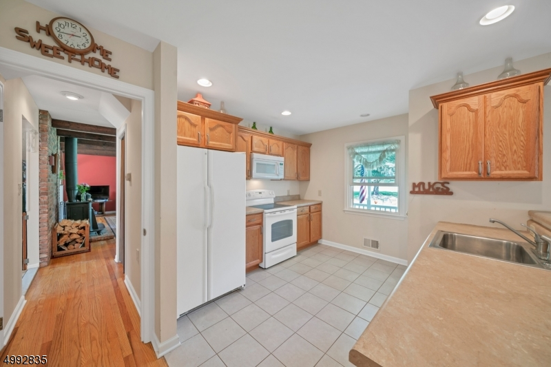 A newer addition to the home includes a spacious and versatile open-concept guest/in-law suite on the first level.