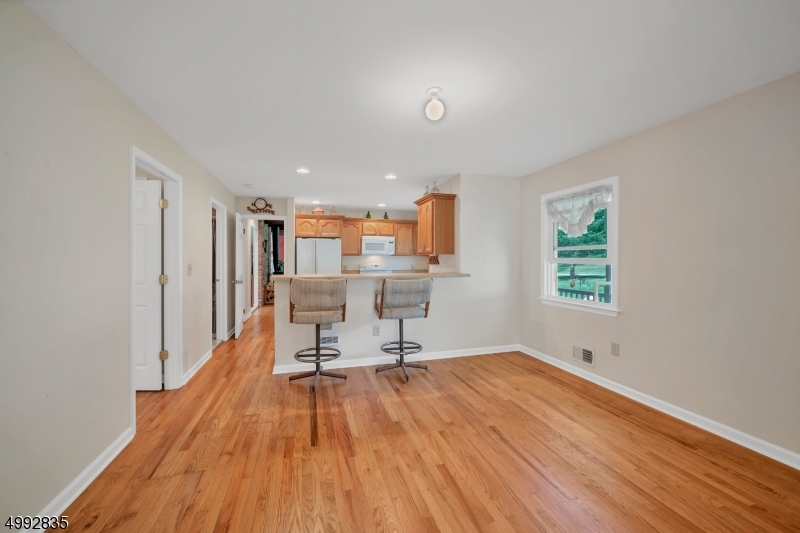 The dining/living area has hardwood floors and open to the kitchen.
