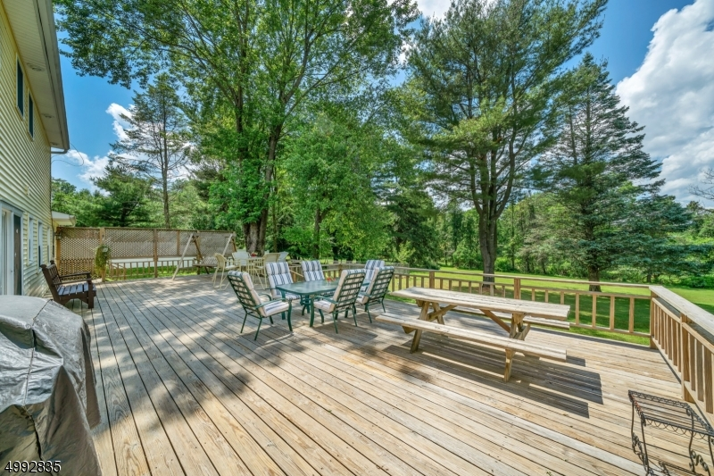 Huge deck with multiple seating areas just perfect for entertaining with access into the home from the kitchen and dining room.