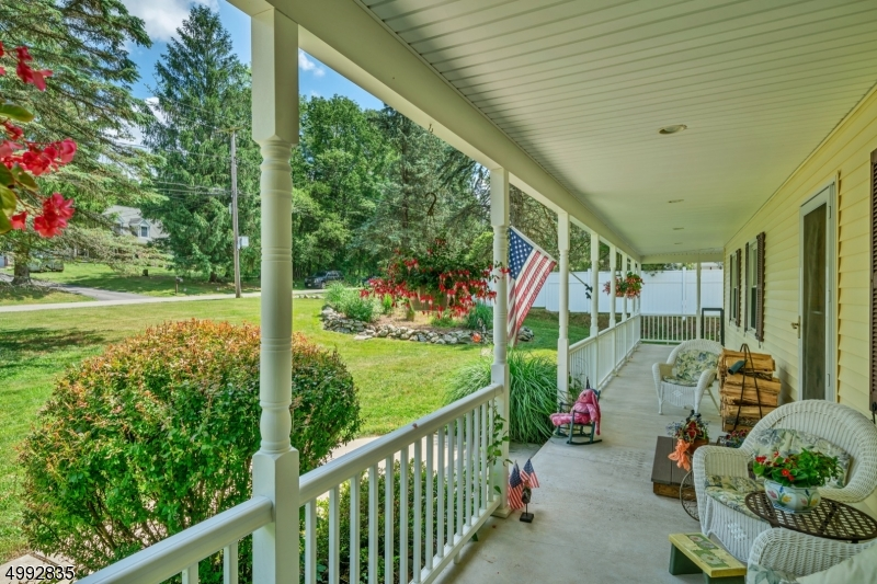 Large wraparound porch welcomes you to the home with several sitting areas.